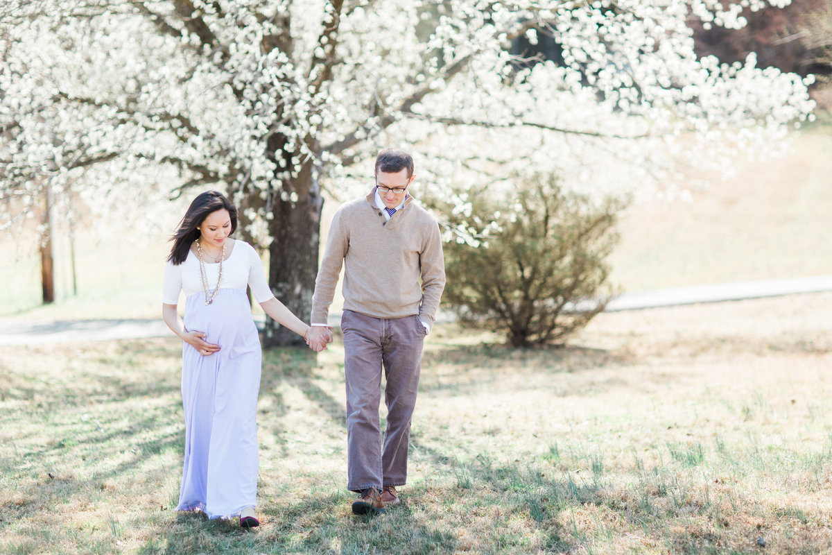 Virginia Maternity Photographer | Chelsea Schaefer Photography | Spring Maternity Session | walking near dogwood tree