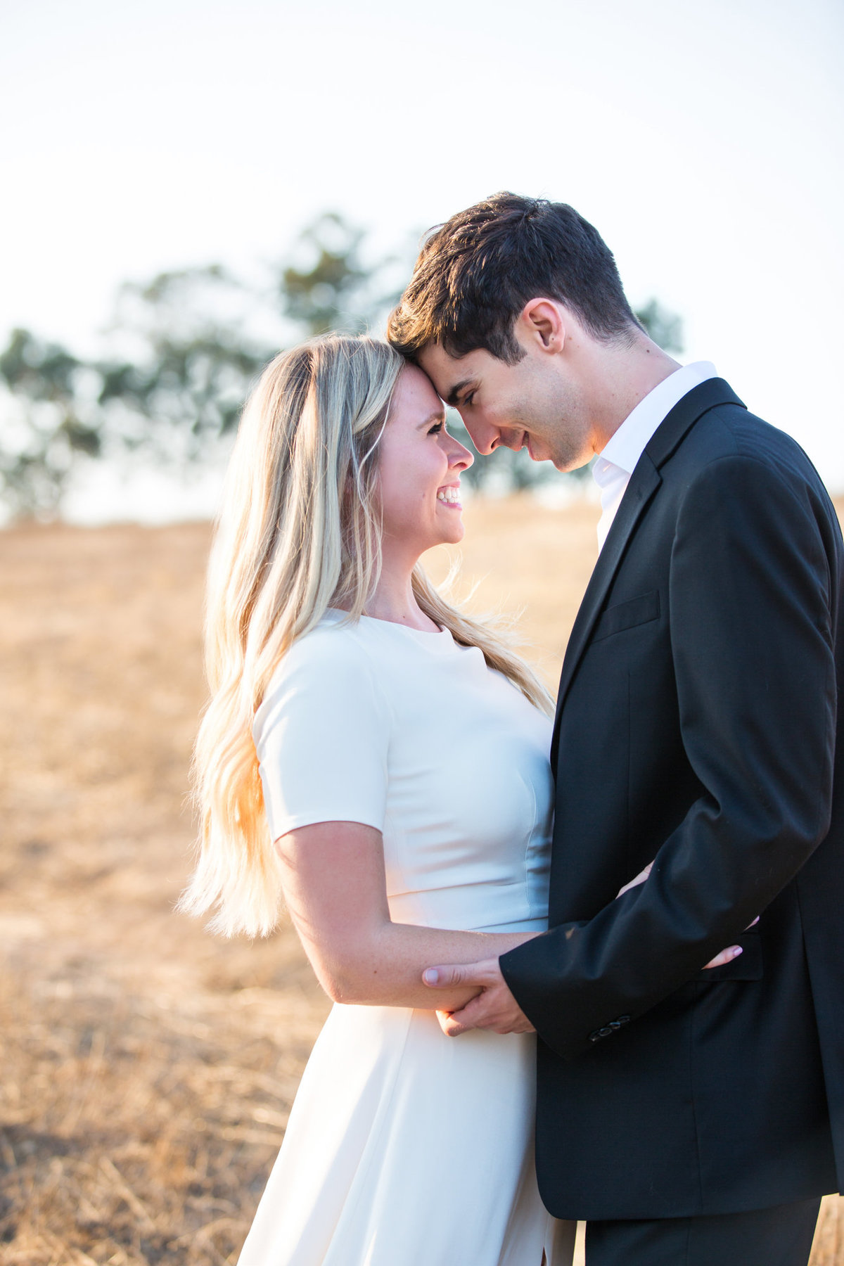 Sunset Engagement Photos in the Tall Yellow Grass in the Hills of Palo Alto
