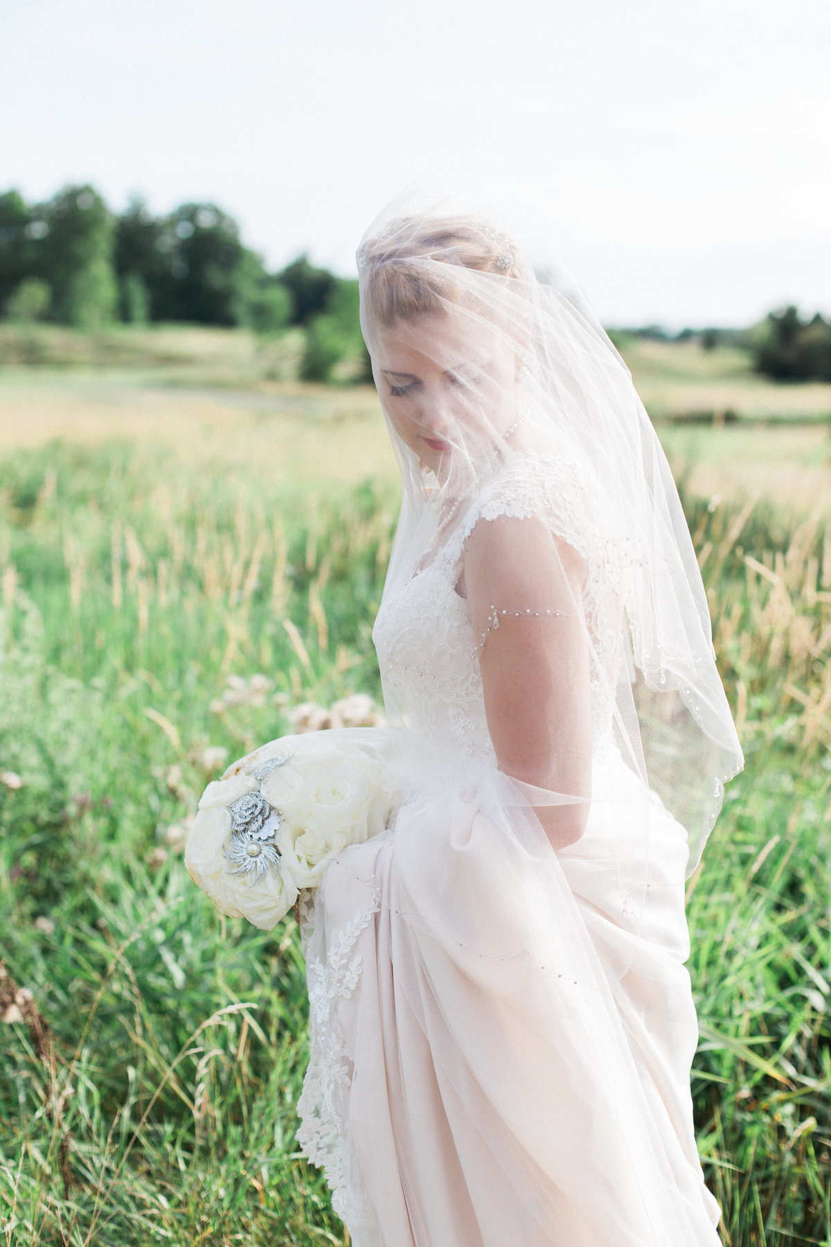 Destination Wedding Photographer Jess Collins Photography at Guelph Wedding Venue Ariss Valley Golf Course, Bride in Veil Wedding Photo