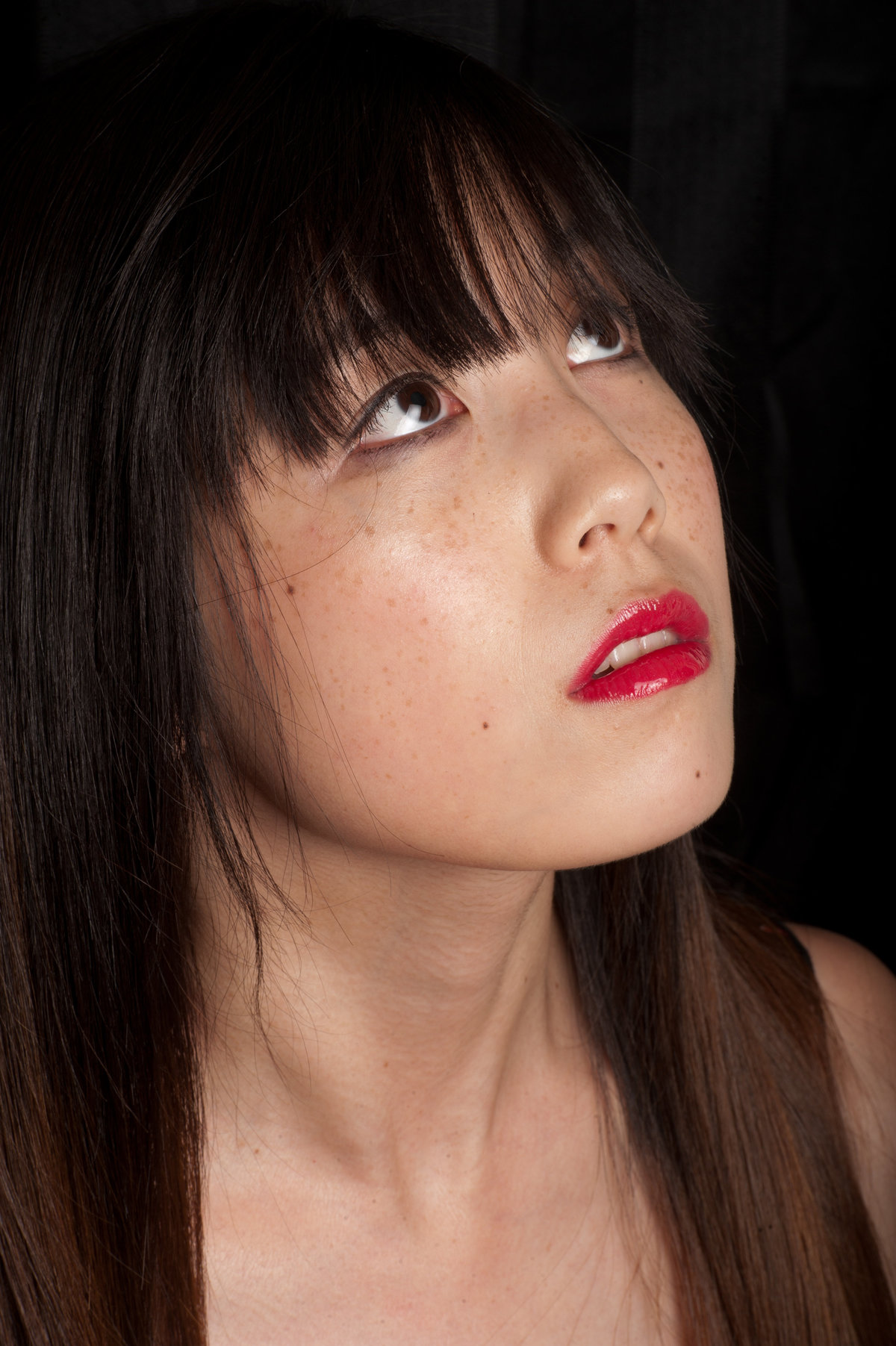 red glossy lips smoked out eyeshadow freckles rosy cheeks asian skin