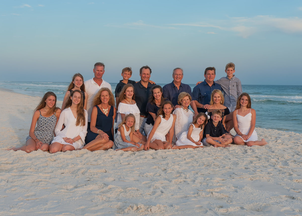 large extended family photographed sitting on the beach in Rosemary on 30a