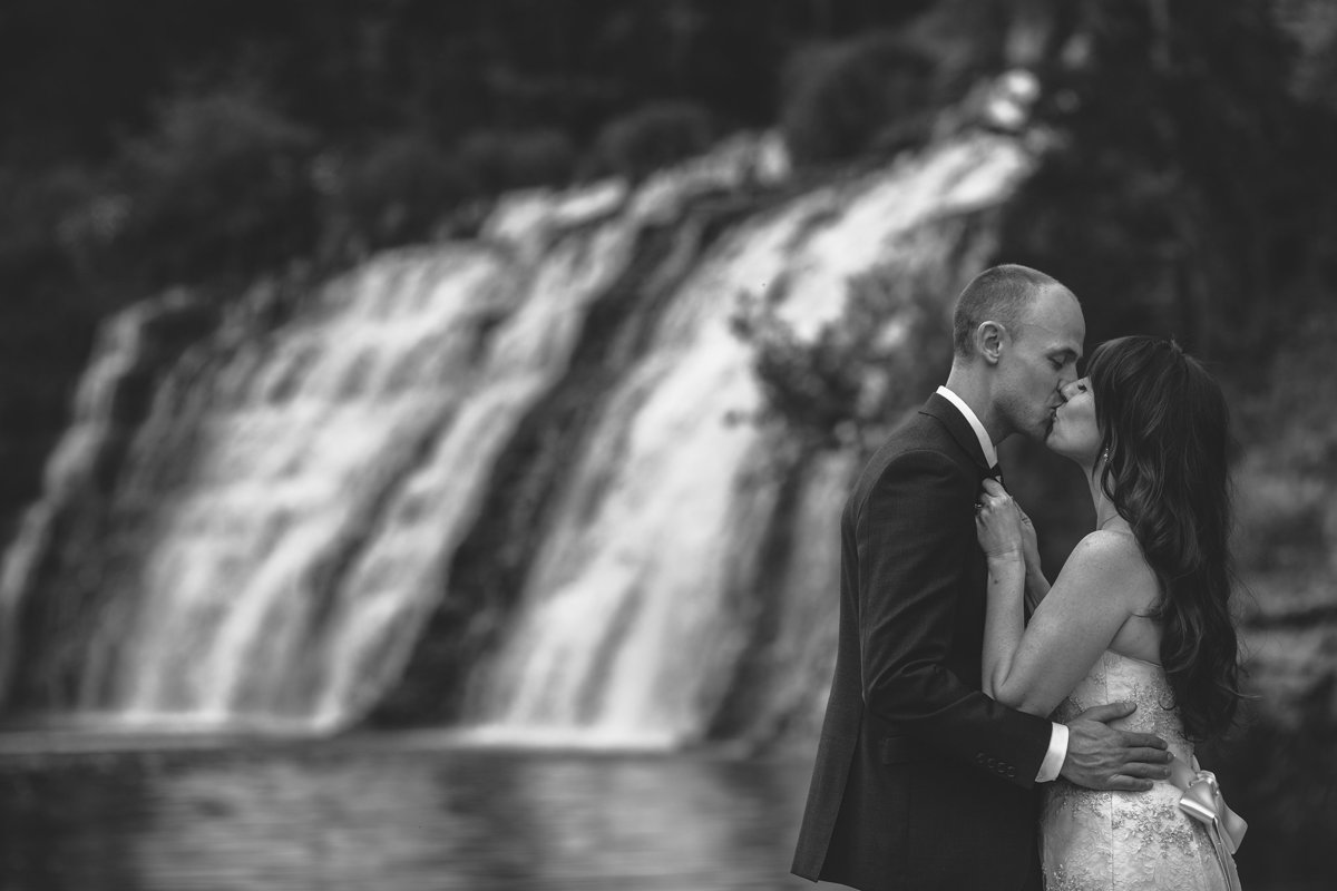 wedding couple in front of a waterfall in galena illinois
