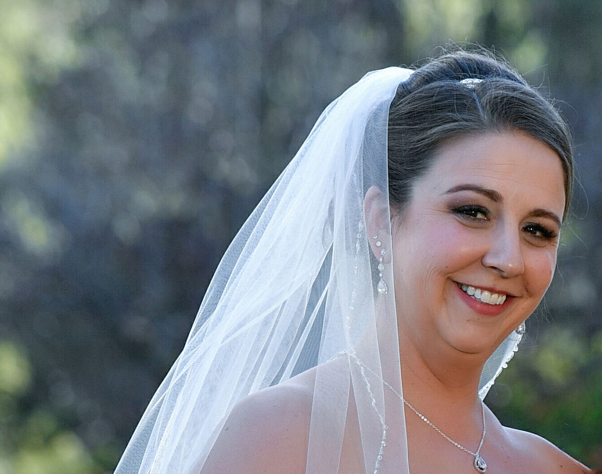 Brunette bride with classic bridal makeup with purple eye makeup lots of lashes
