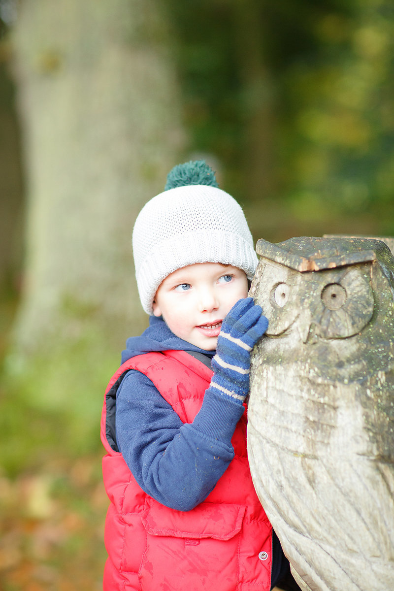 little boy in wooly hat and gloves