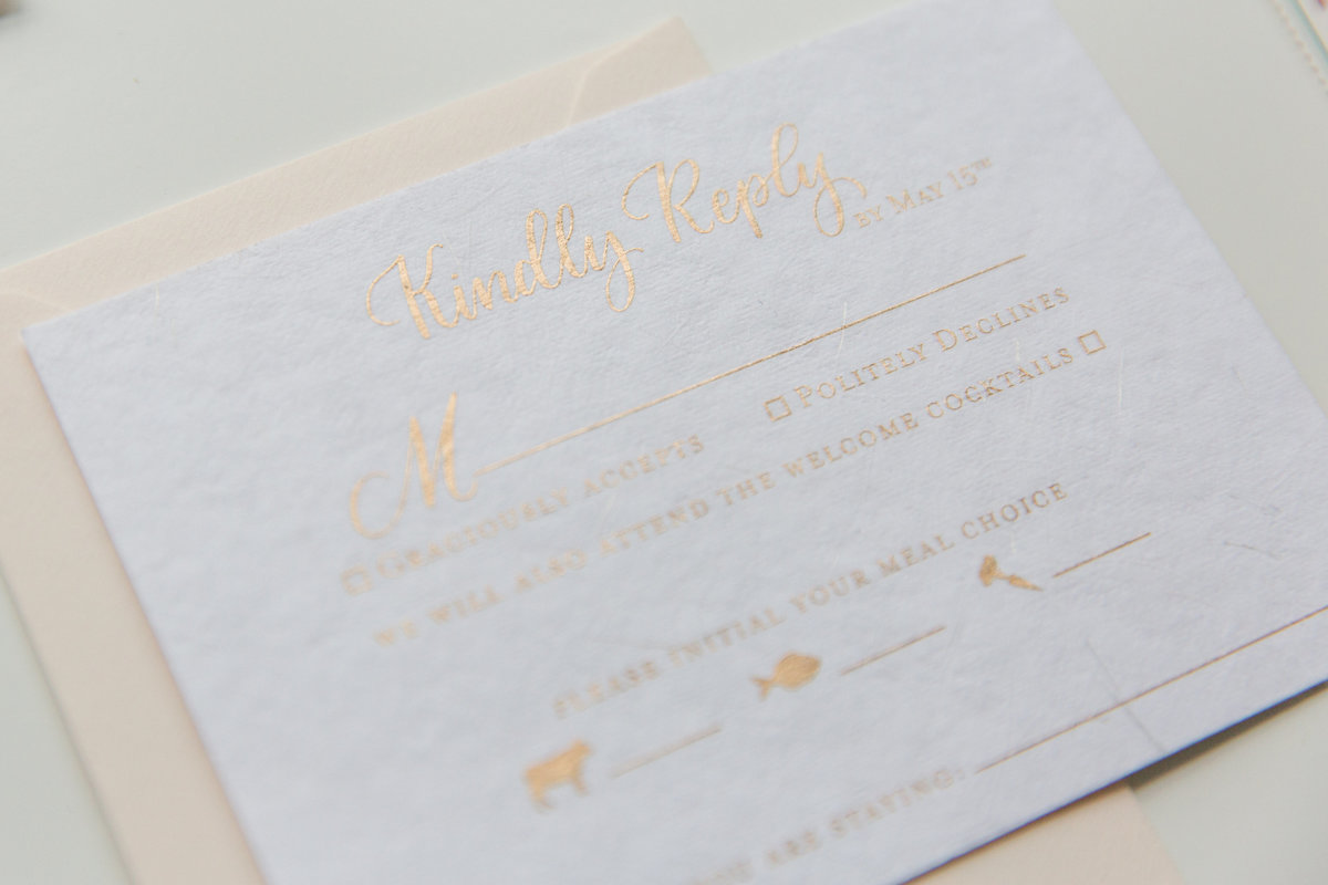 Wedding RSVP details with custom calligraphy in gold ink