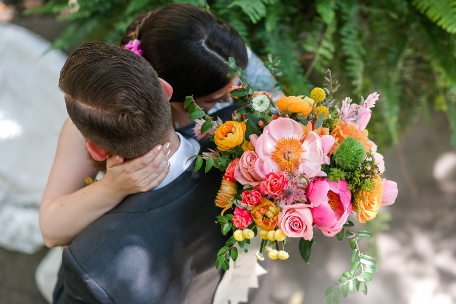 Shot from above of bride and groom  and bride holding bouquet