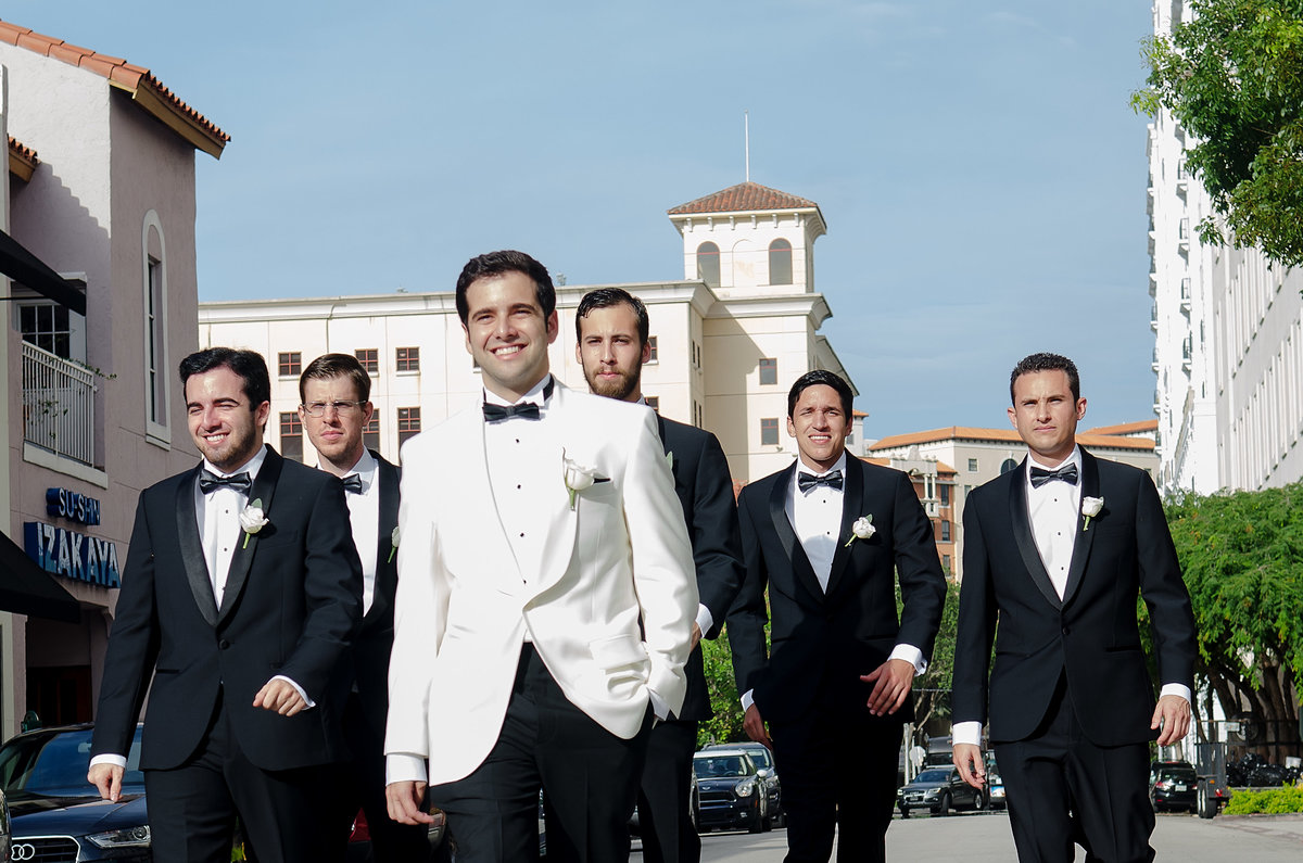 Grooms walking down Miracle Mile
