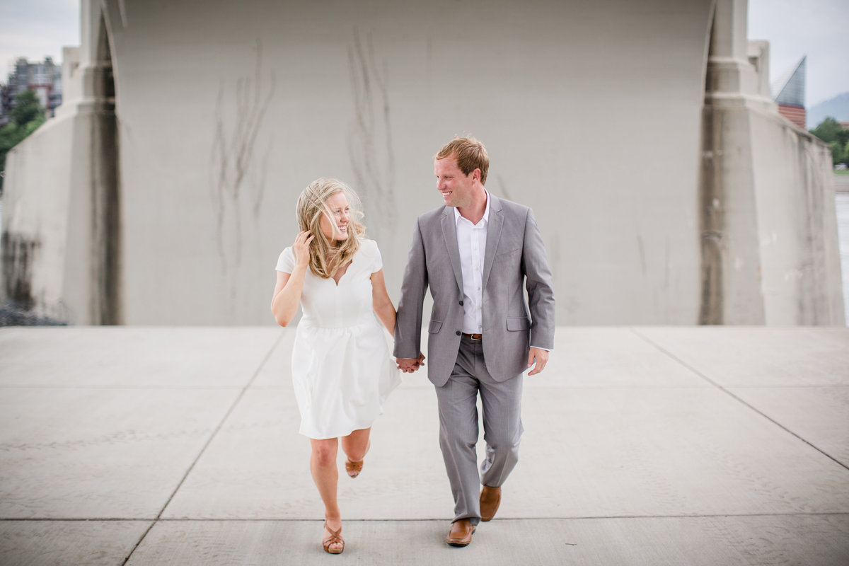 Running under a bridge by Knoxville Wedding Photographer, Amanda May Photos.
