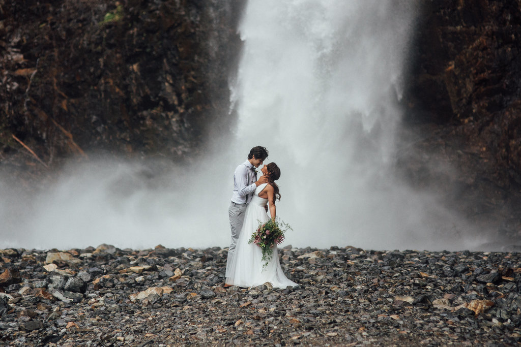Waterfall elopement of the bride and groom eloping outside in Seattle, Washington.
