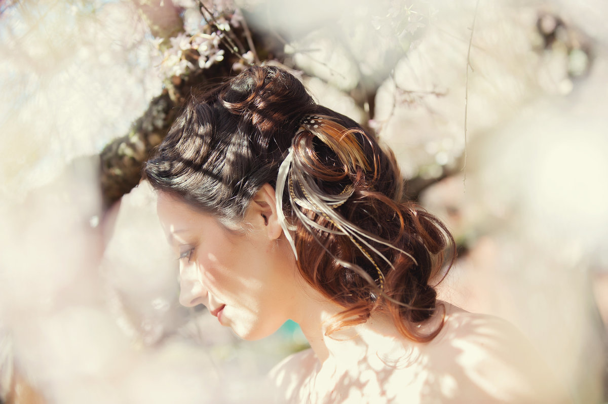 portrait of bride inside a cherry blossom tree