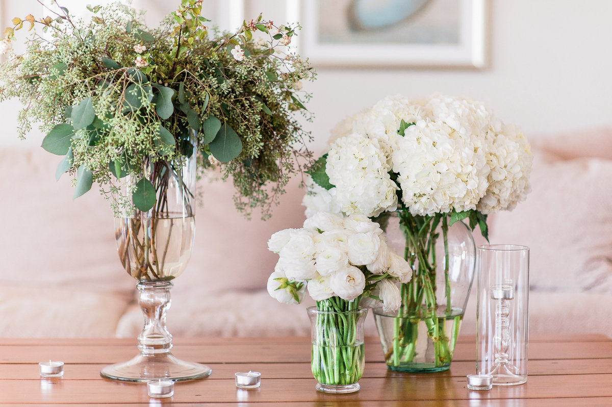 white wedding flowers in tall glass vases by Arkansas wedding photographer Christy Hendrick of Simply Bliss Photography