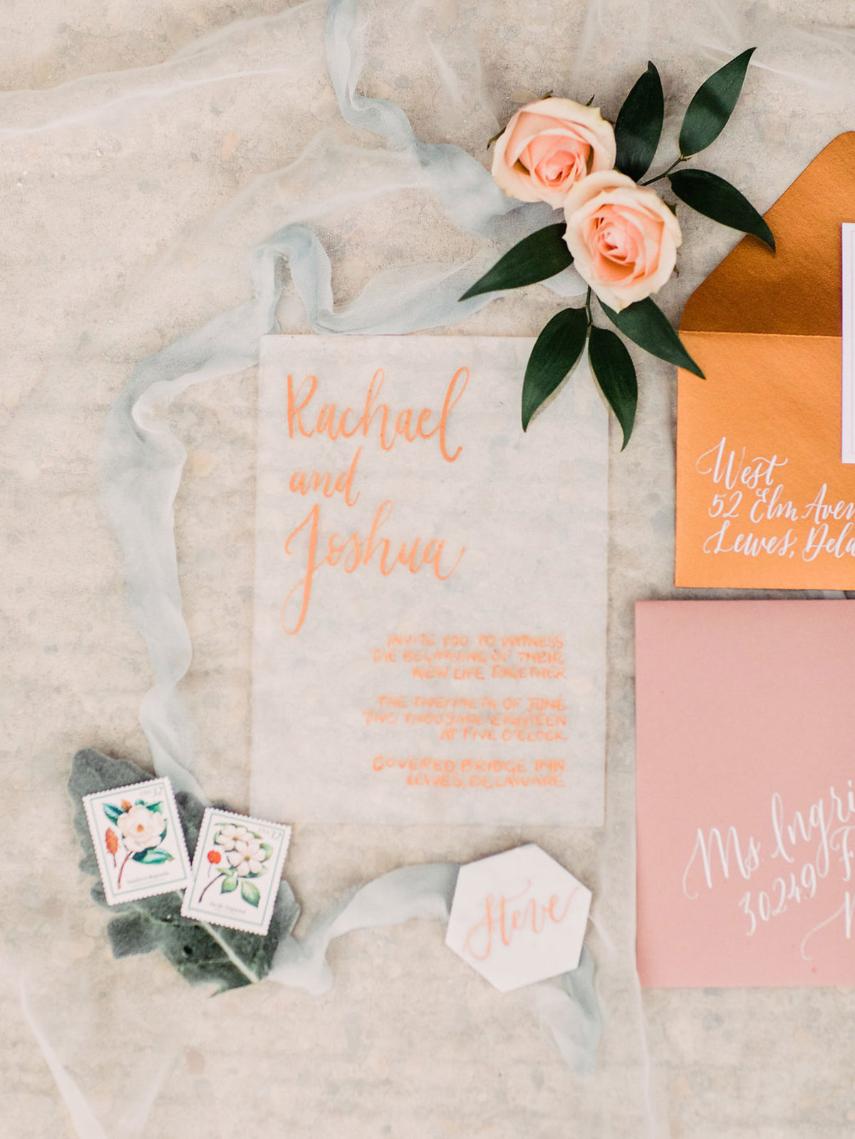 Modern hand lettered wedding invitations with gold and peach