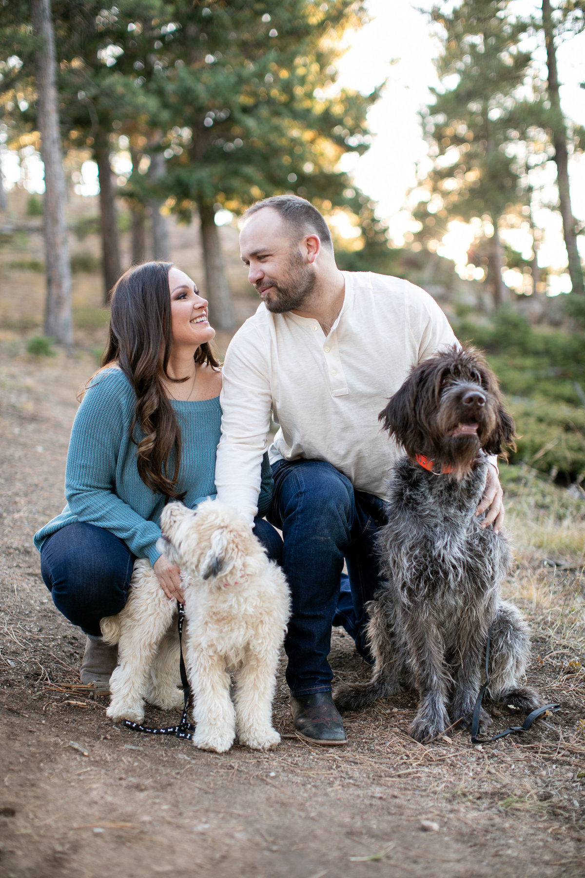Engaged couple posing with their 2 dogs during their engagement photos