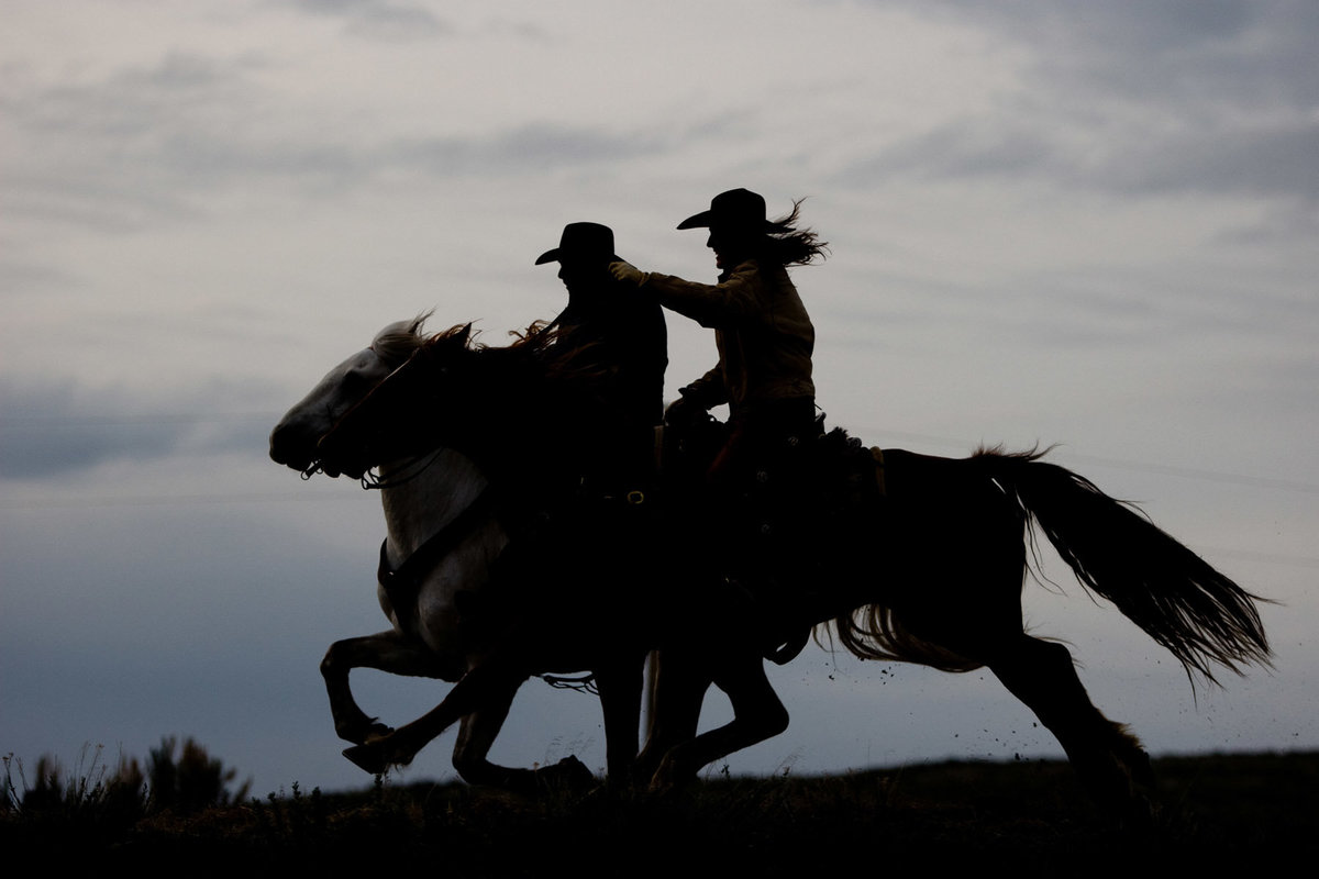 cowboys and horses running photographer  Lynette Smith Photography