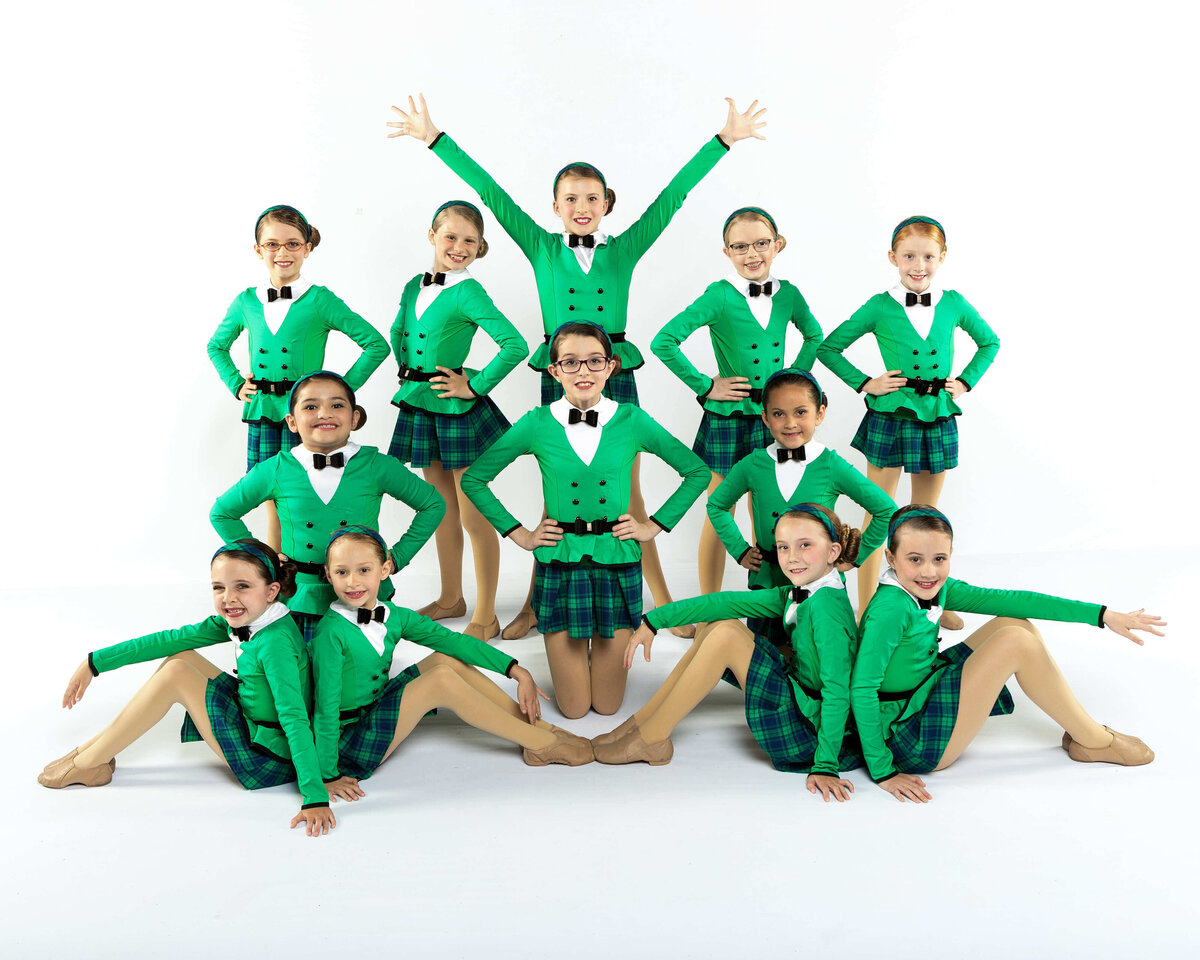 Performers in green costumes