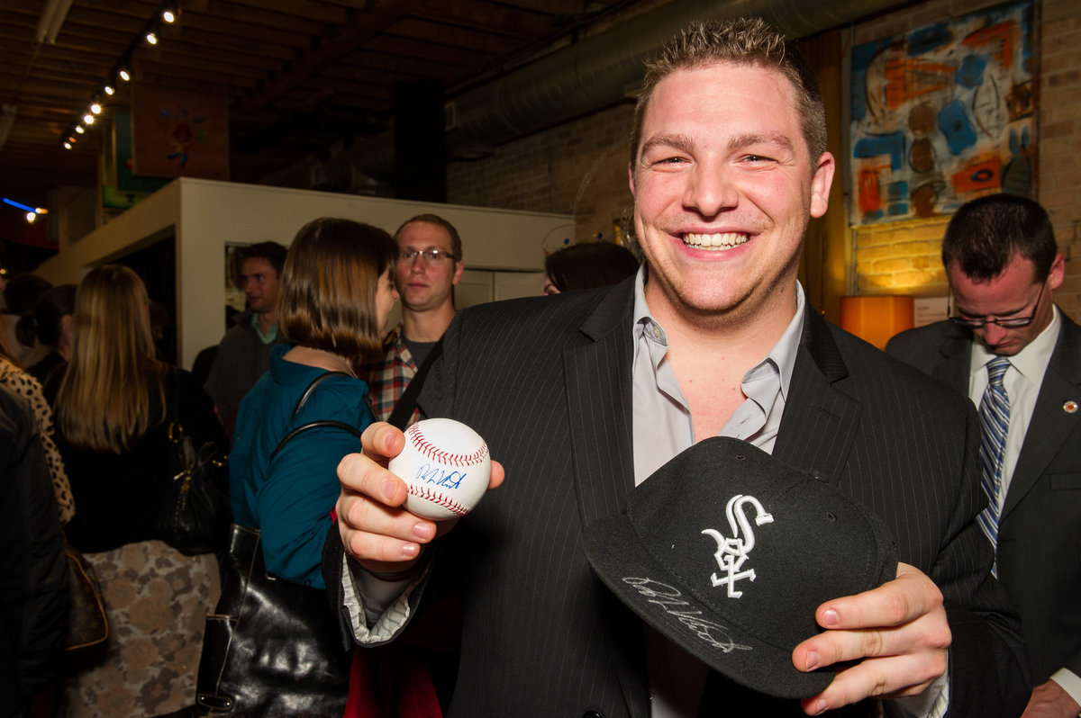 Guest shows off White Sox prize at Chicago fundraising event