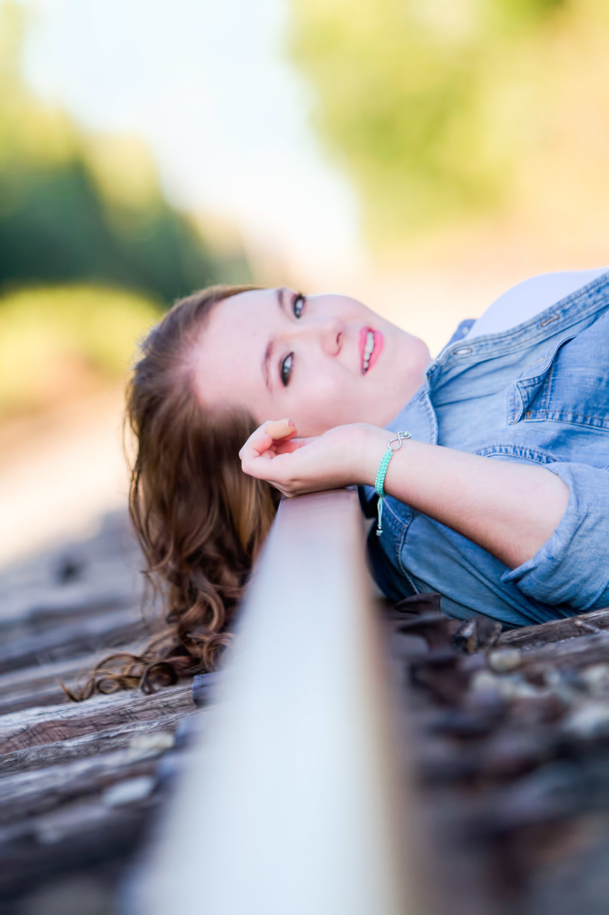 Girl Senior portrait on railroad track