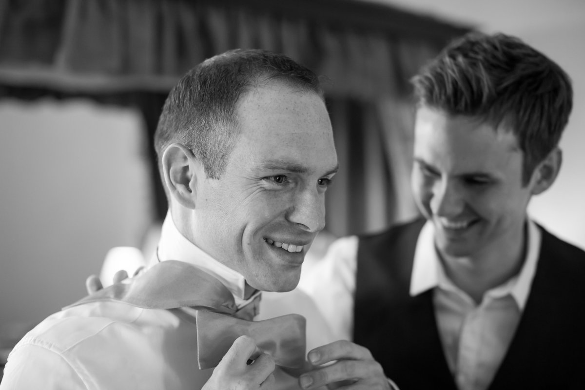 groom and best man getting ready at st audries park