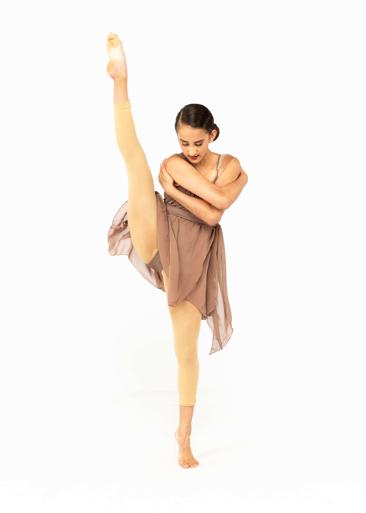 Modern dancer in brown flowy dress