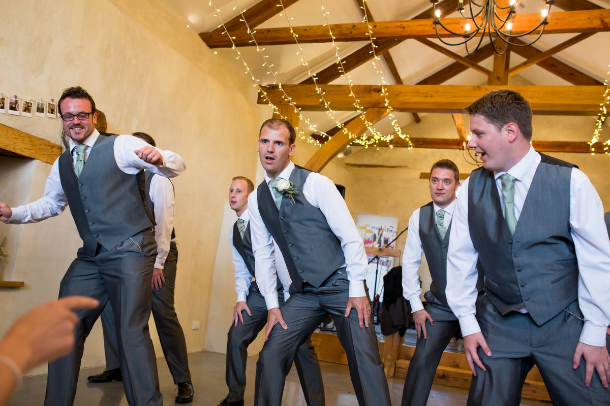 groomsmen dancing at upton barn