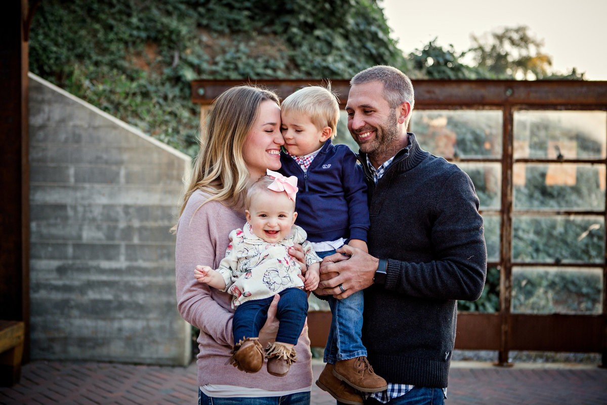 Family of four at The Standard Wedding Venue by Knoxville Wedding Photographer, Amanda May Photos.