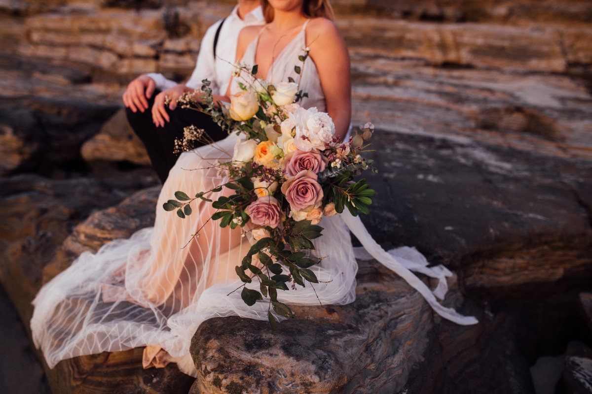 Bridal bouquet during sunset on the beach elopement in San Diego California