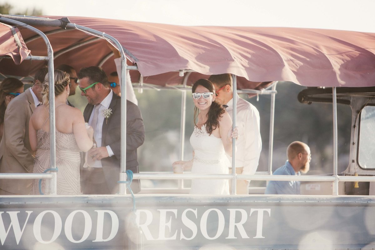 Bride and groom take a boat ride on Lake Wawasee wedding