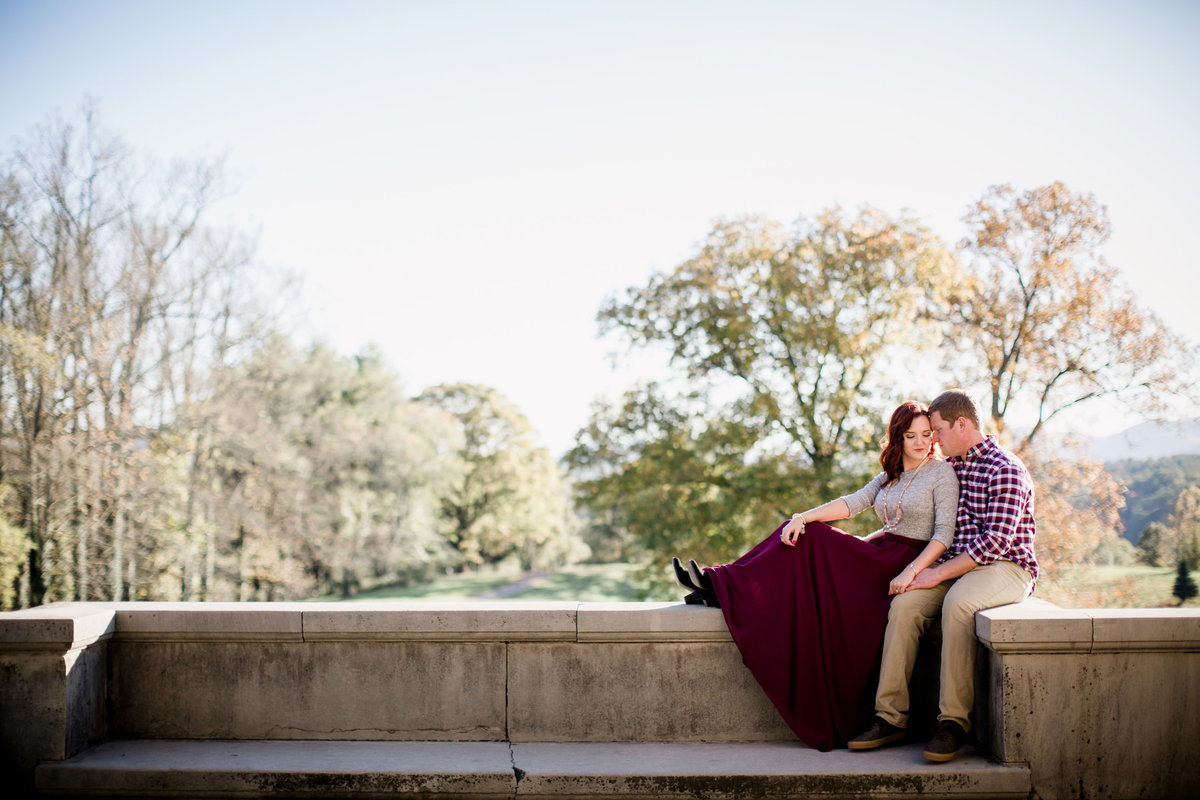 Sitting on the ledge at the Biltmore in the light by Knoxville Wedding Photographer, Amanda May Photos.