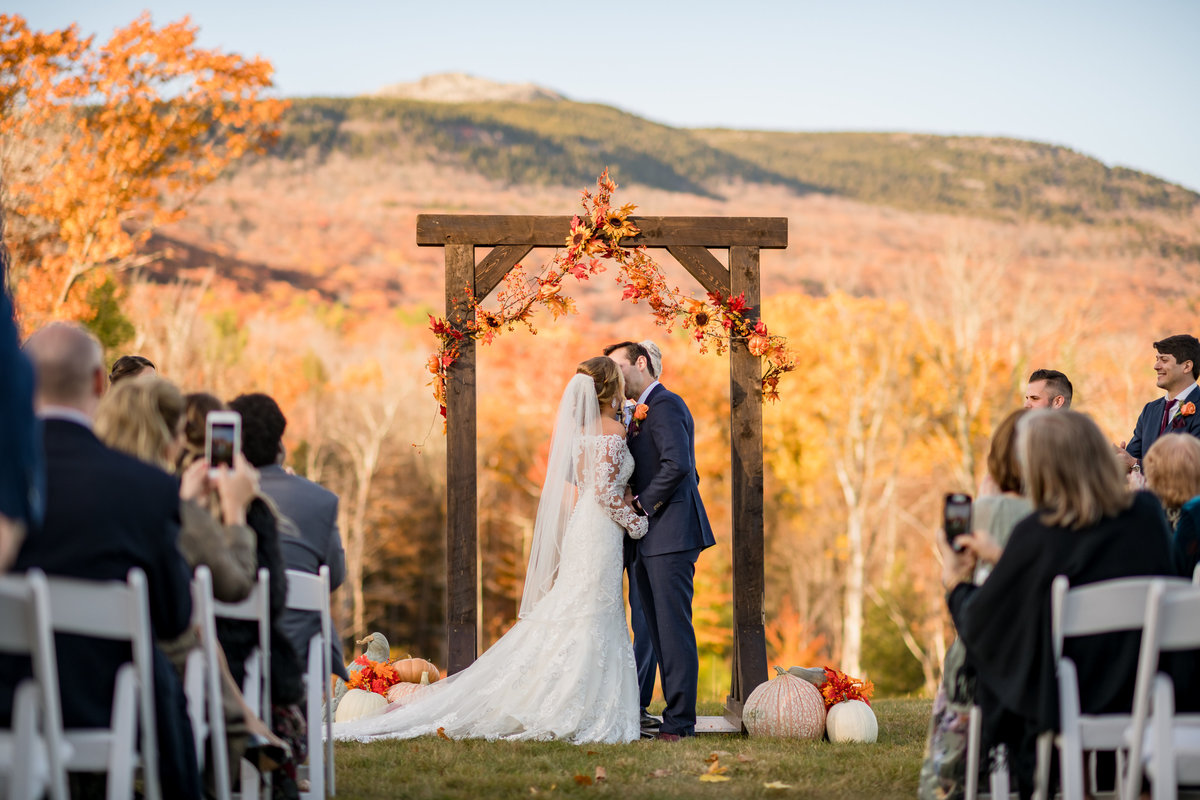 first kiss in the fall with mountain views