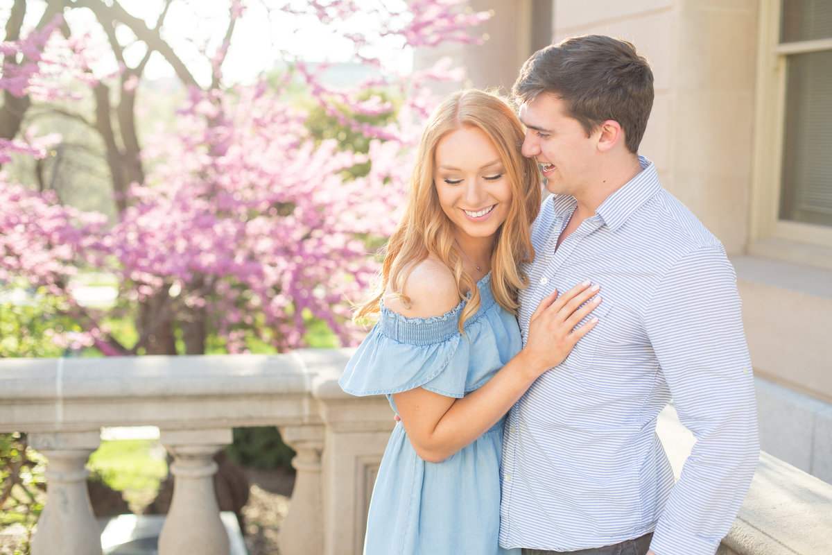 golden-hour-spring-cherry-blossom-blue-dress-red-hair-candid-engagement-photo