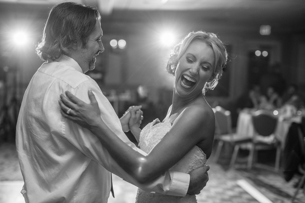 bride dancing with her brother artrockford country  club in rockford illinois