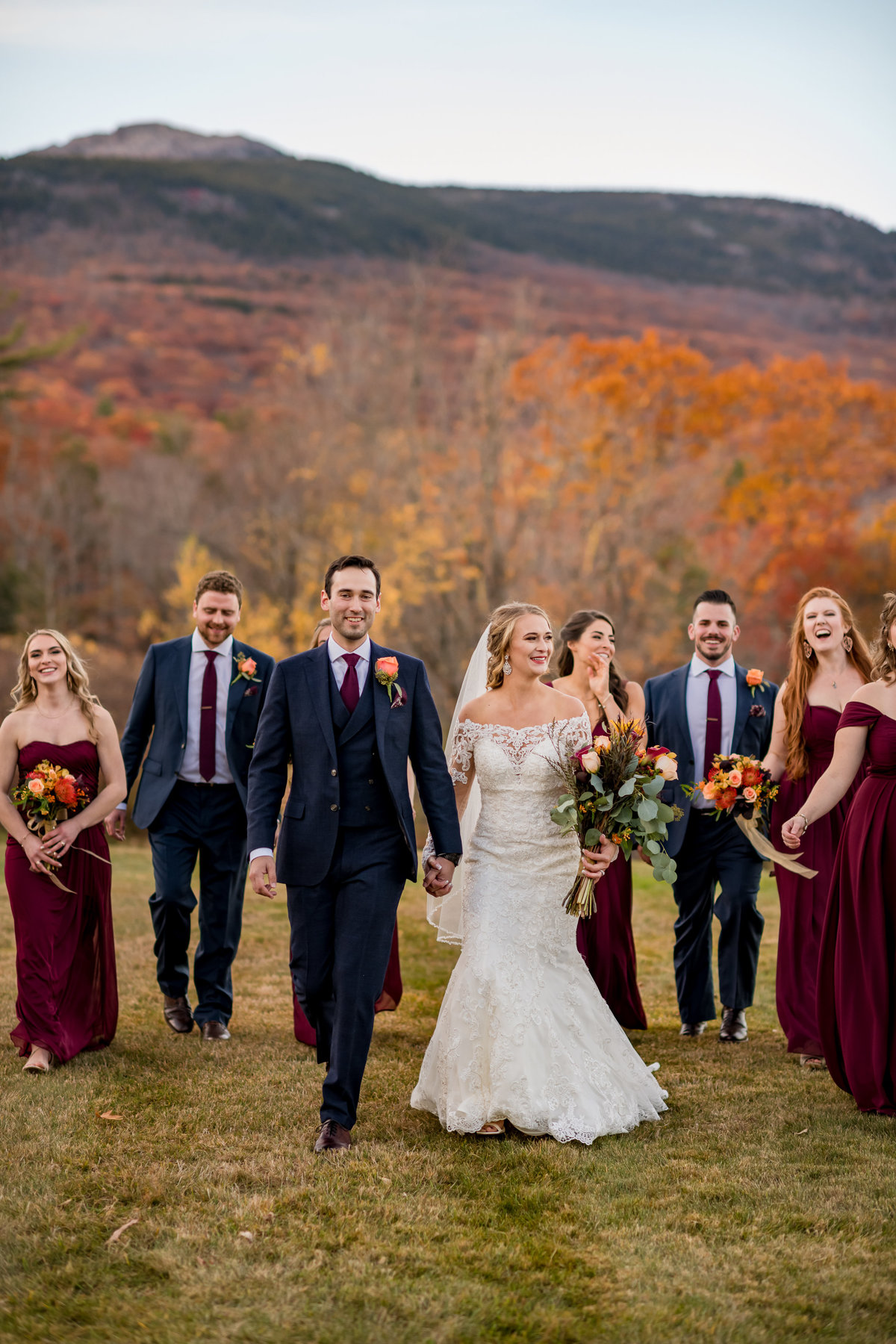 wedding party walking with mountain views