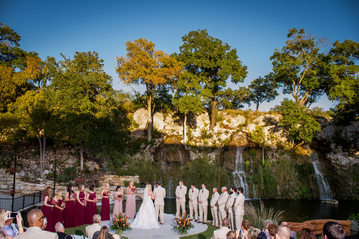 bridal party standing with bride and groom at wedding ceremony at Remi's Ridge at Hidden Falls Wedding venue