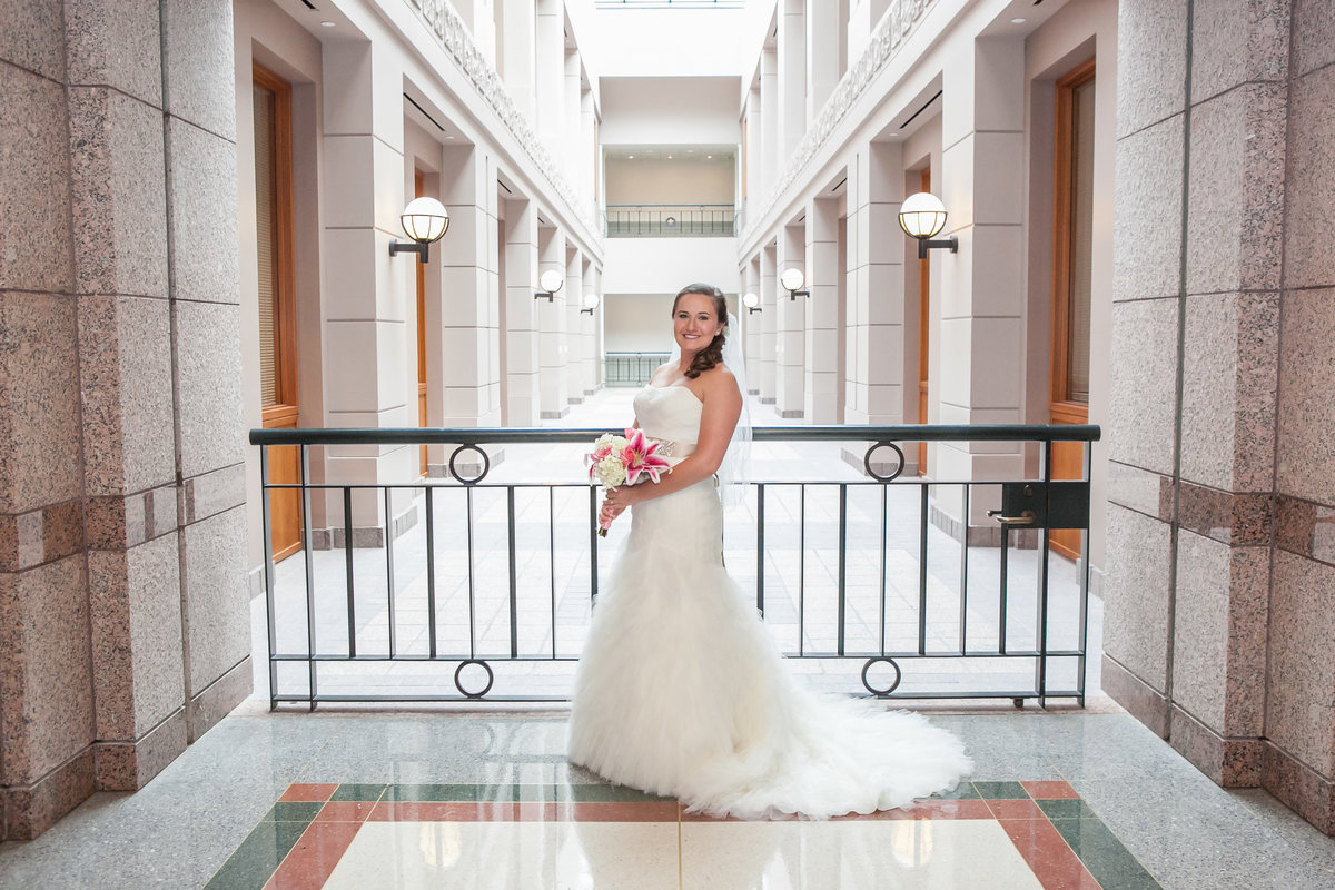 Austin Family Photographer, Tiffany Chapman, bride in state capital building  smiling photo