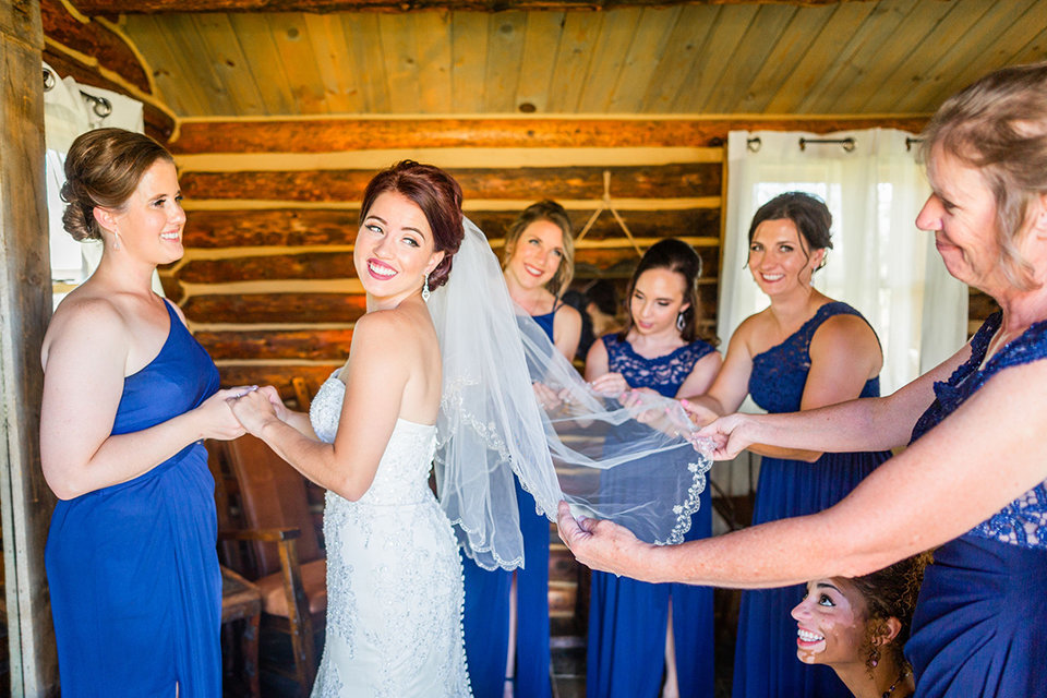 granby-colorado-Strawberry-Creek-Ranch-Wedding-Ashley-McKenzie-Photography-tropic-meets-mountain-wedding-colorful-putting-on-the-veil
