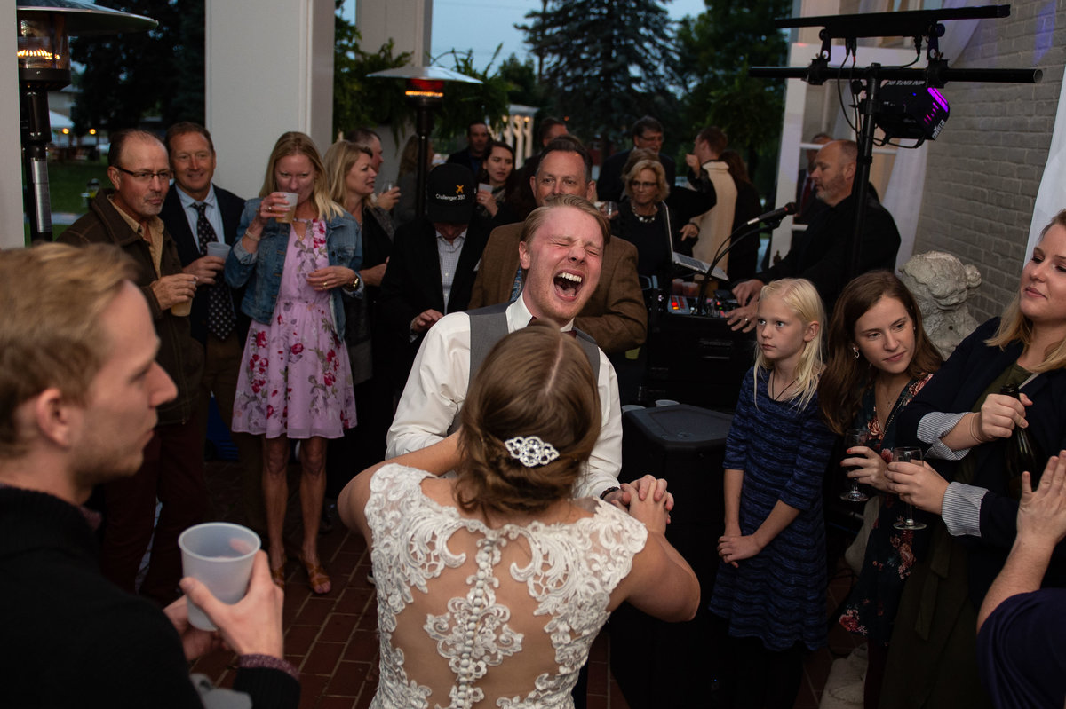 man of honor throws head back in screaming laughter
