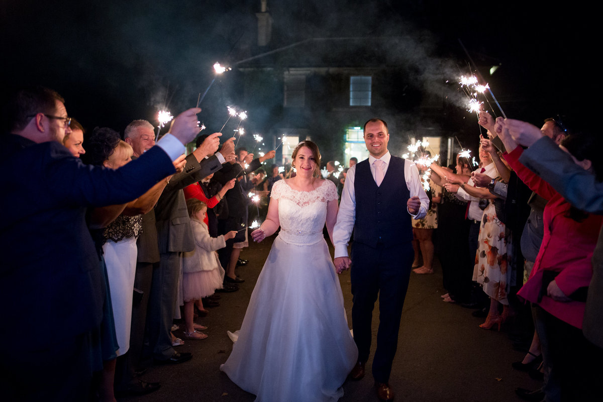 couple with sparkler exit at the horn of plenty