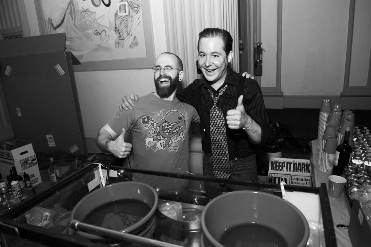 Bartenders smile and serve drinks at Chicago launch party event.