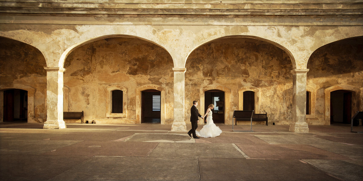 Bride and groom walking in San Cristobal during destination wedding
