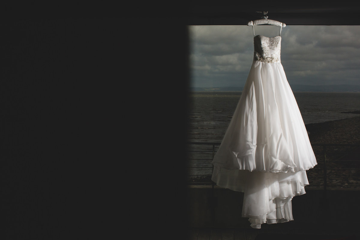 a wedding dress hanging in the window at the midland hotel