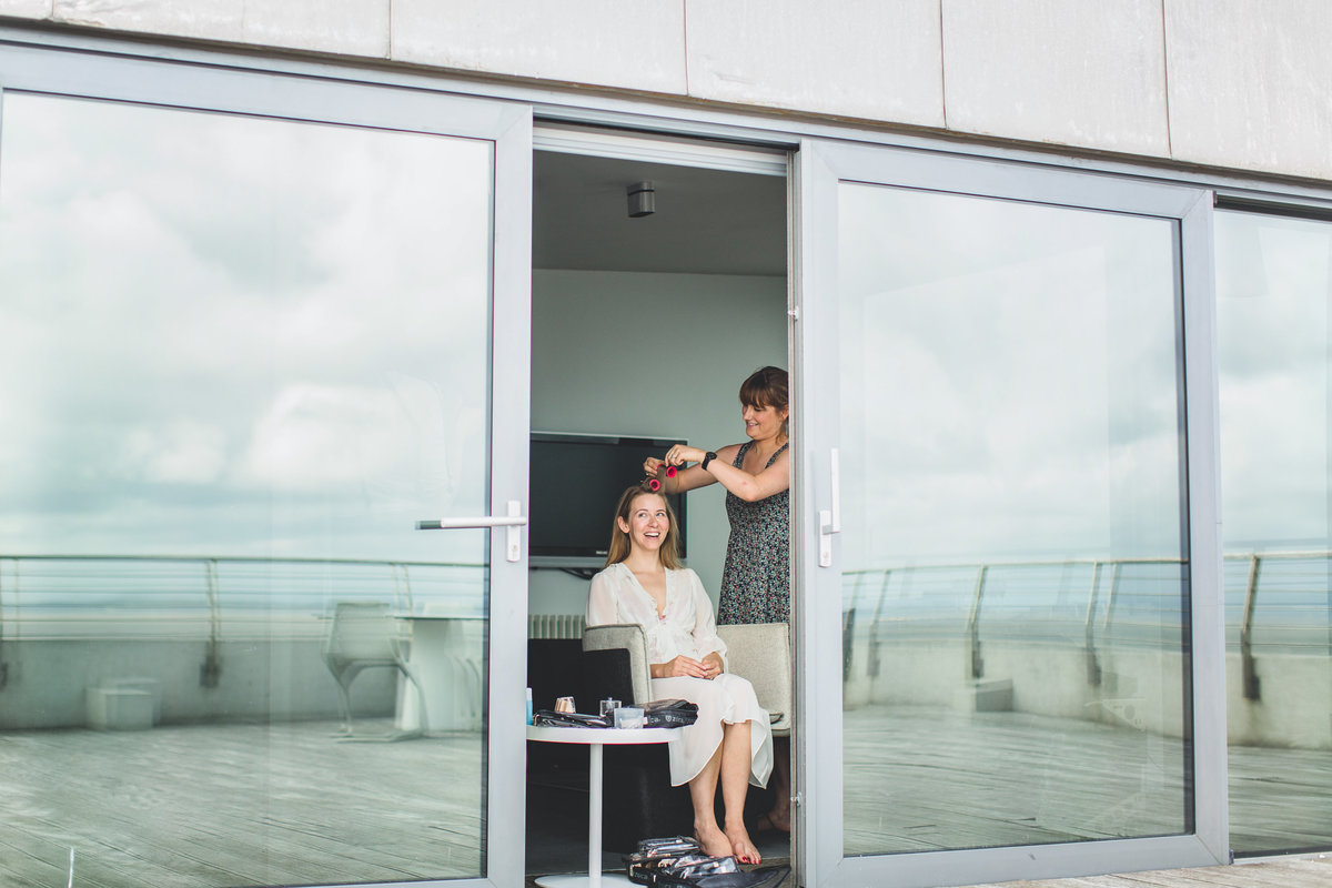 bride having her hair done at the midland hotel in morecambe on the roof