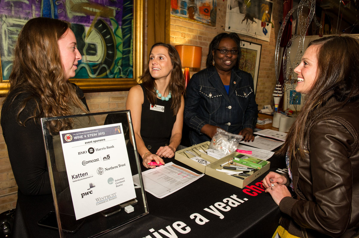 Volunteers chat with attendees at Chicago Wine & Stein event.