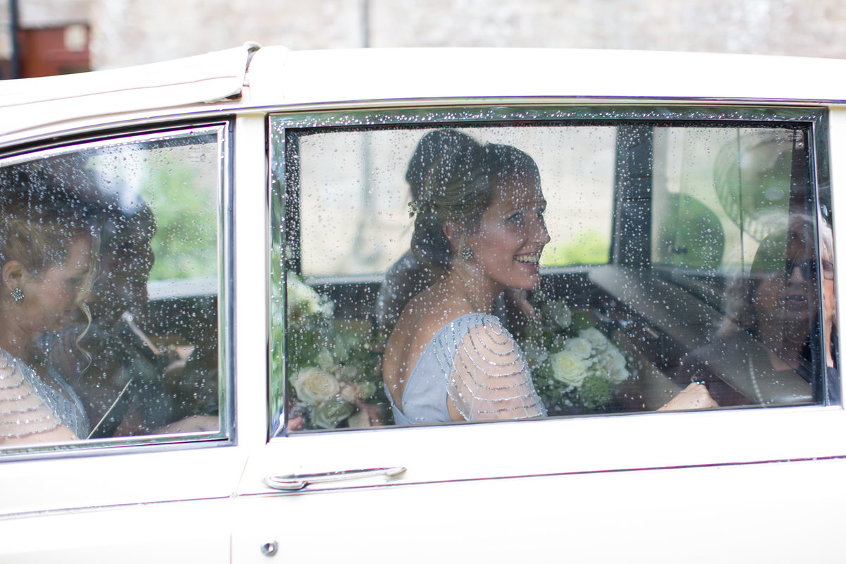 bridesmaids in wedding car at haselbury mill