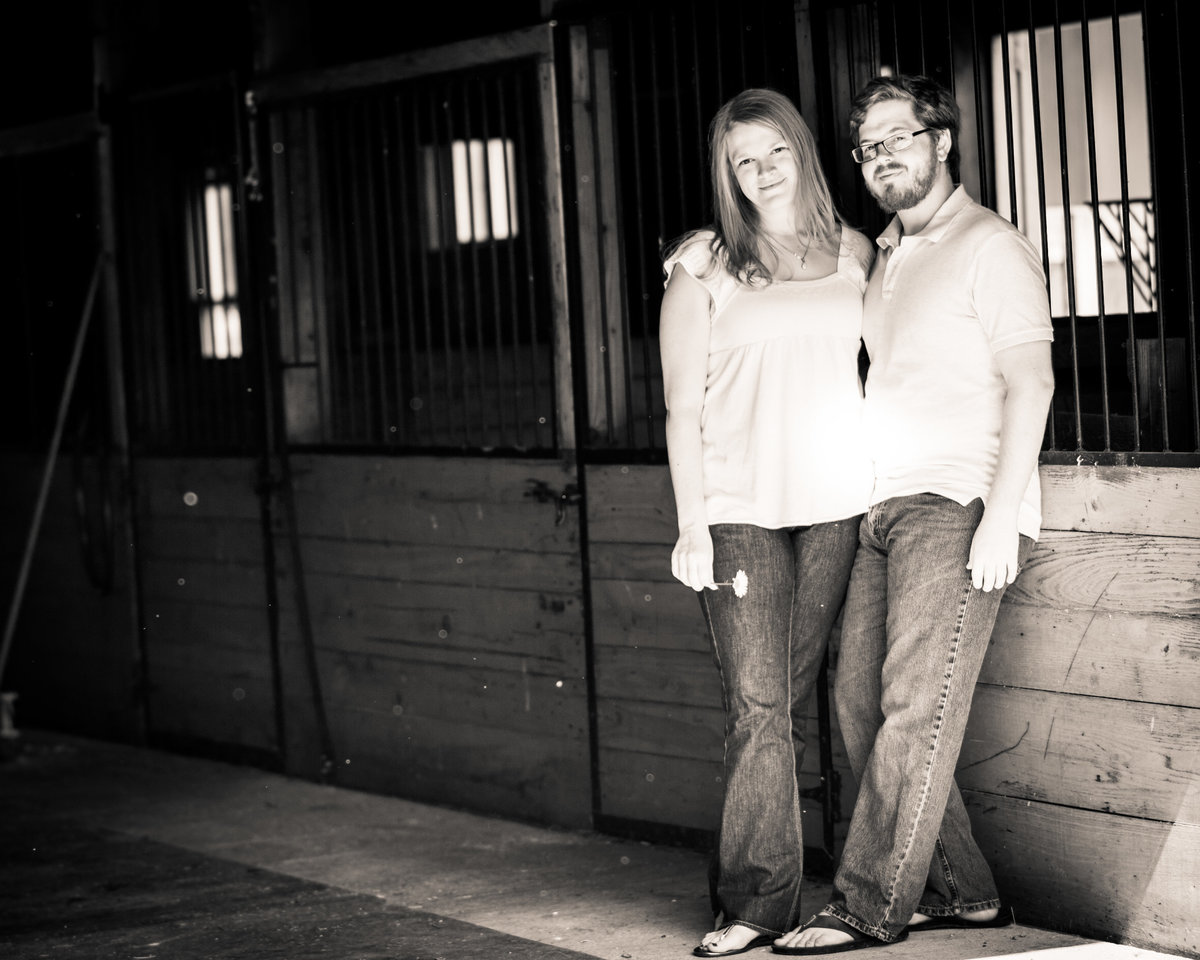 Couple poses in stables for engagement - Huntsburg, OH.