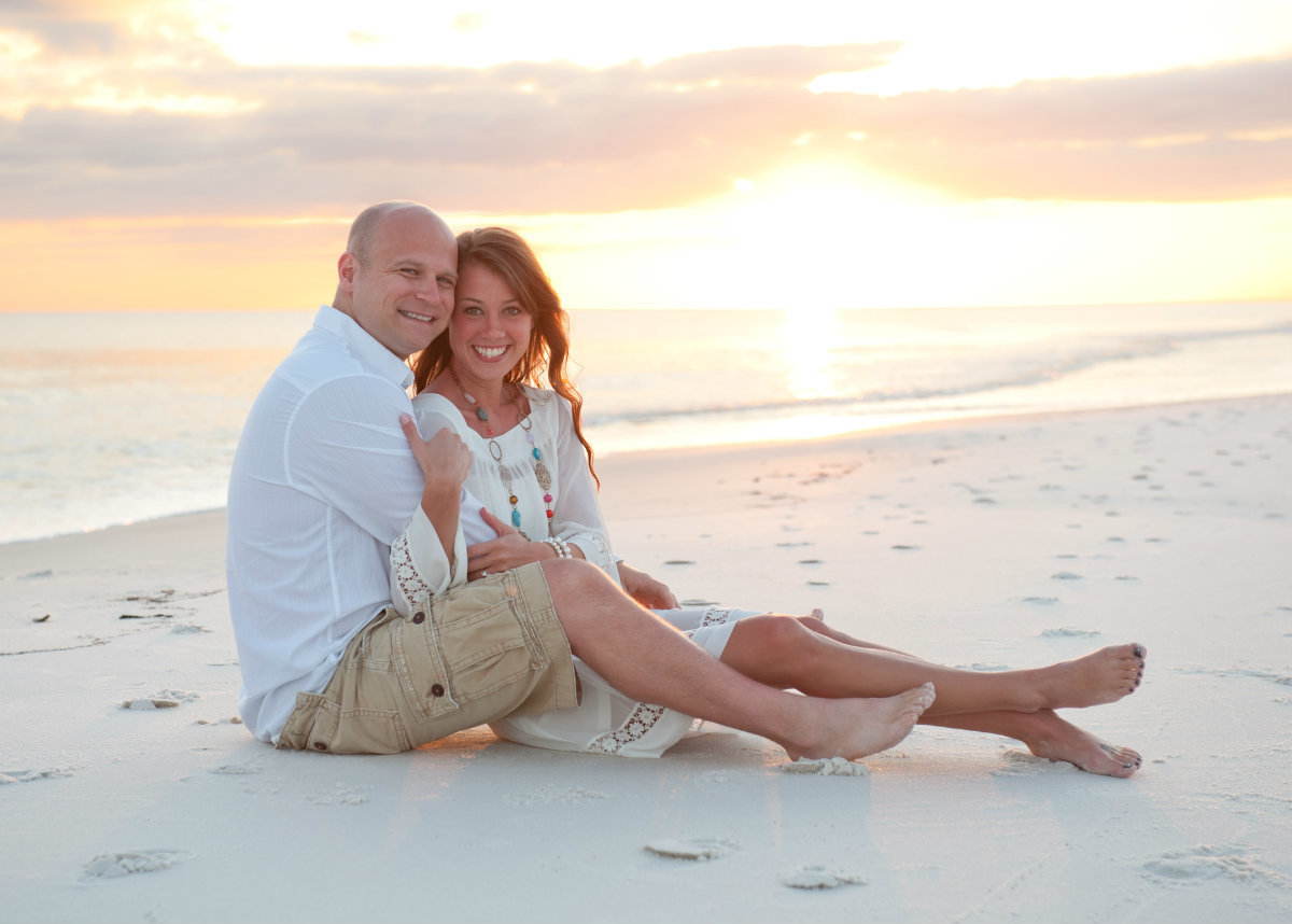 Couple posed on the Seagrove beach at sunset