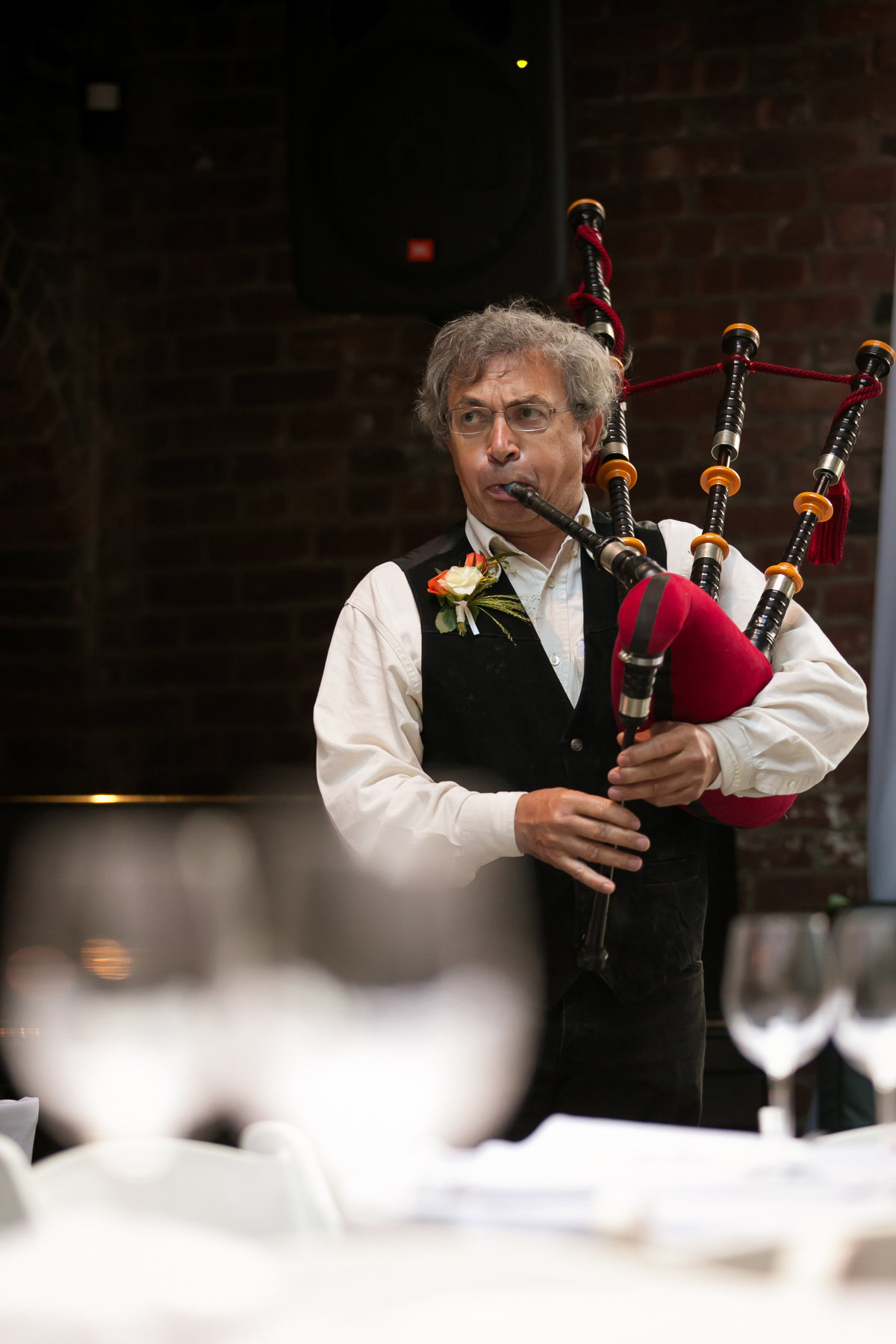 Brooklyn Wedding Photographer | Rob Allen Photography | Destination Wedding Photographer at Foundry in Long Island City New York Mels father playing bagpipes during ceremony