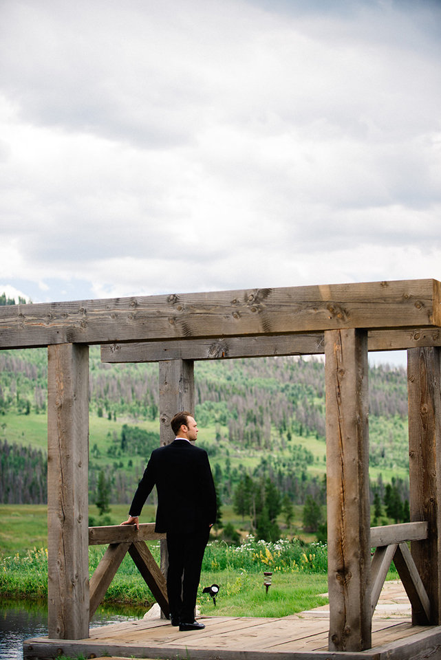 Strawberry-Creek-Ranch-Modern-Minimalist-Outdoor-wedding-in-Granby-Colorado-Groom-Gazing
