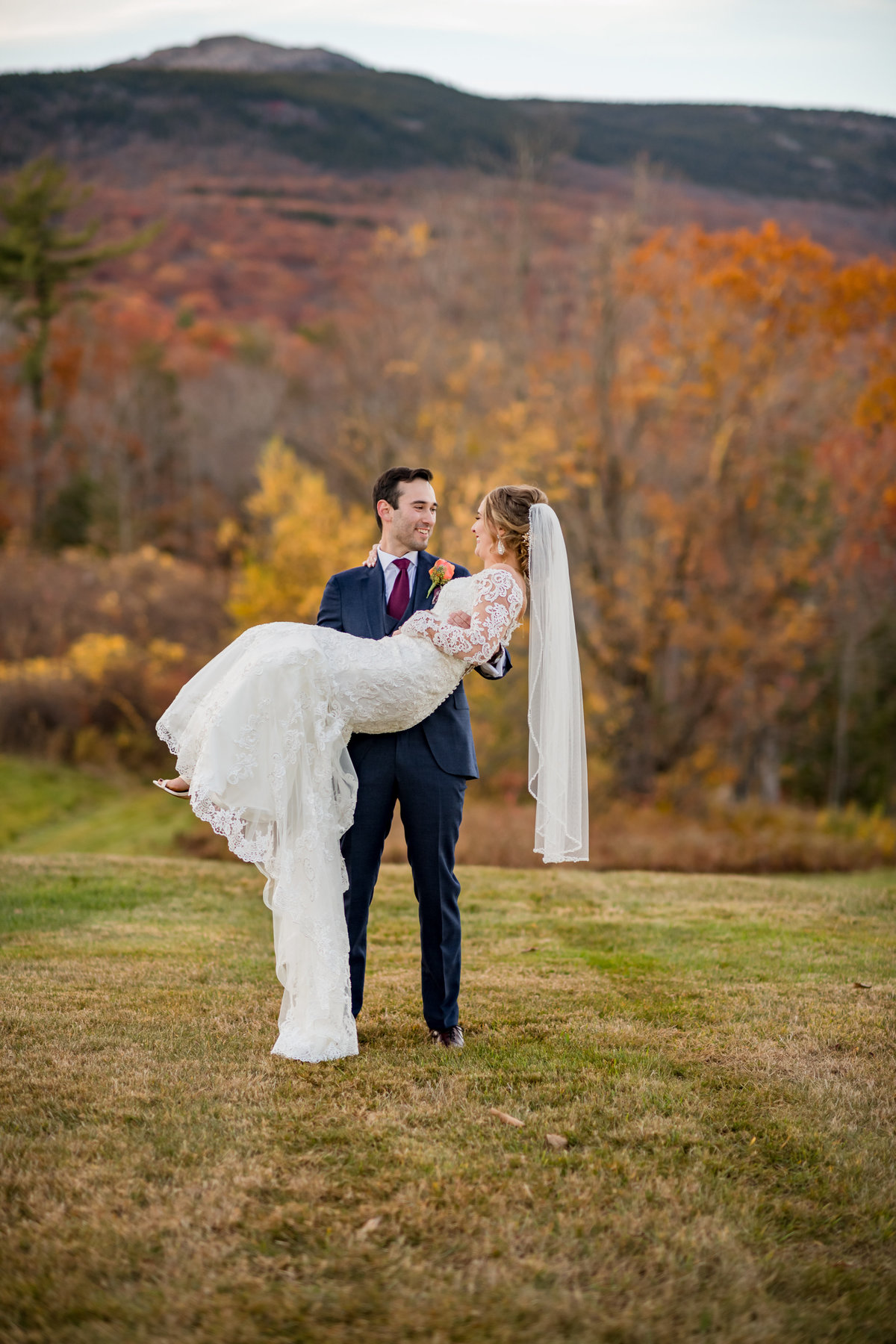 groom picks up bride during couple portraits