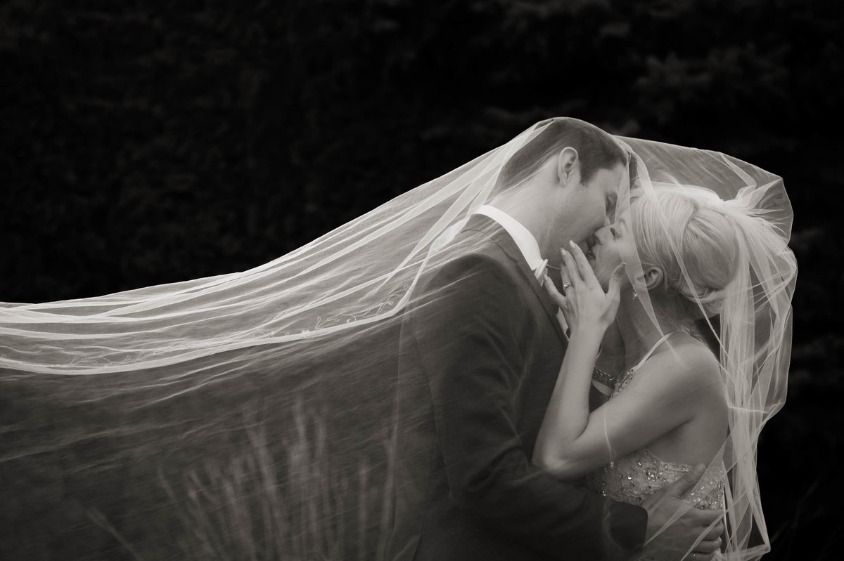 Kelowna Wedding Bride and groom kissing under veil