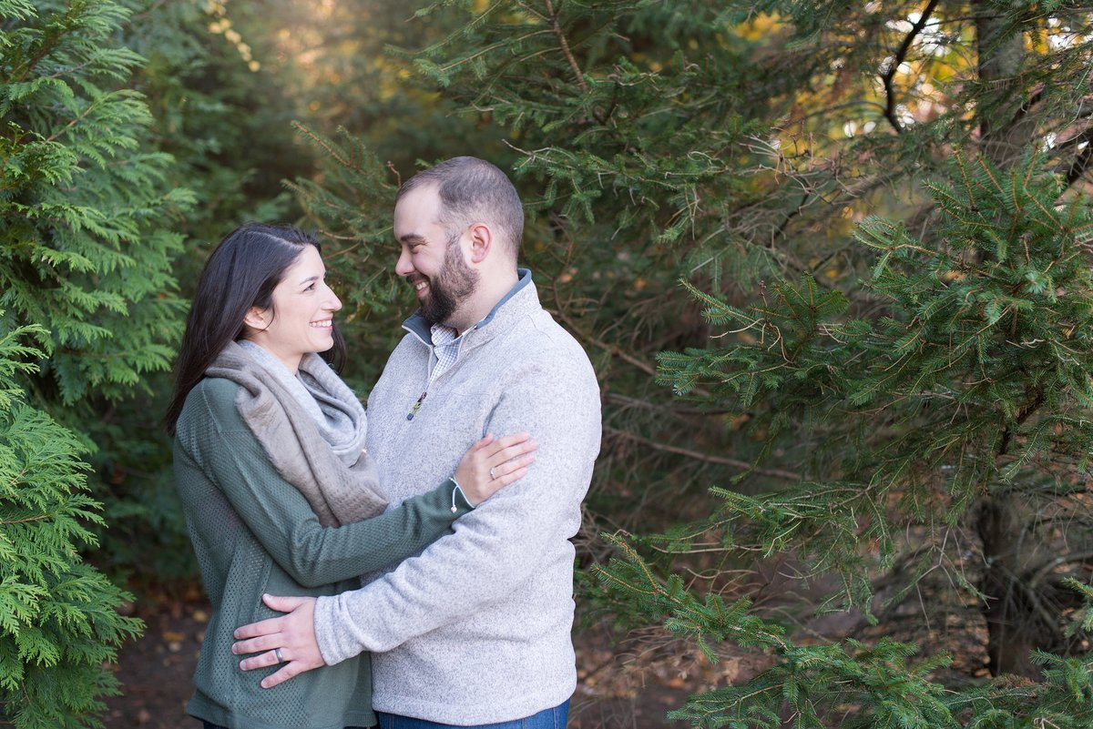 Husband and Wife looking at each other in a winter family session in White Plains, NY Photo